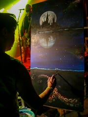 Marcy Moon paints an image during last year's sold-out Harry Potter Yule Ball hosted by Pensacon and Vinyl Music Hall. Get your tickets now for this year's event on Saturday.