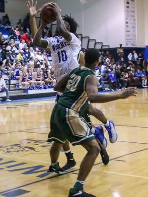 Washington's Eric Goldsmith (10) tries to push his way to the basket through Catholic's Kyheem Coleman (20) and Nitrell Bledsoe (23) at Washington High School on Friday, January 26, 2018.