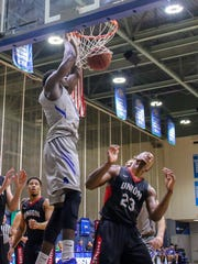 UWF's Darryl Tucker (21) lays down an easy dunk against Union University in the last regular season home game at the University of West Florida Field House on Saturday, Feb. 17, 2018.