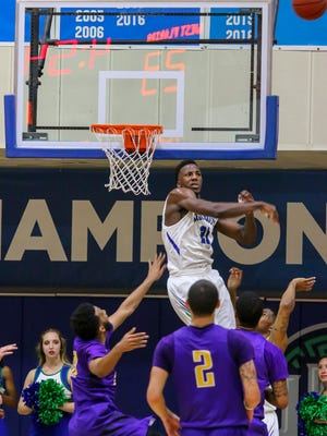 UWF's Darryl Tucker (21) unequivocally denies a shot by Montevallo's Deshawn Jones (10) during a Gulf South Conference Tournament game at the University of West Florida Field House on Tuesday, Feb. 27, 2018. Seeded number two, UWF beat #7 Montavello 83-74.