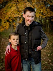 "Brothers Colin White, 8, and Gavin, 13, ""have their"