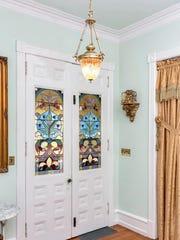 The front door features the original stain glass window design.