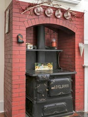The kitchen features a 1920's Adelphia wood burning stove.
