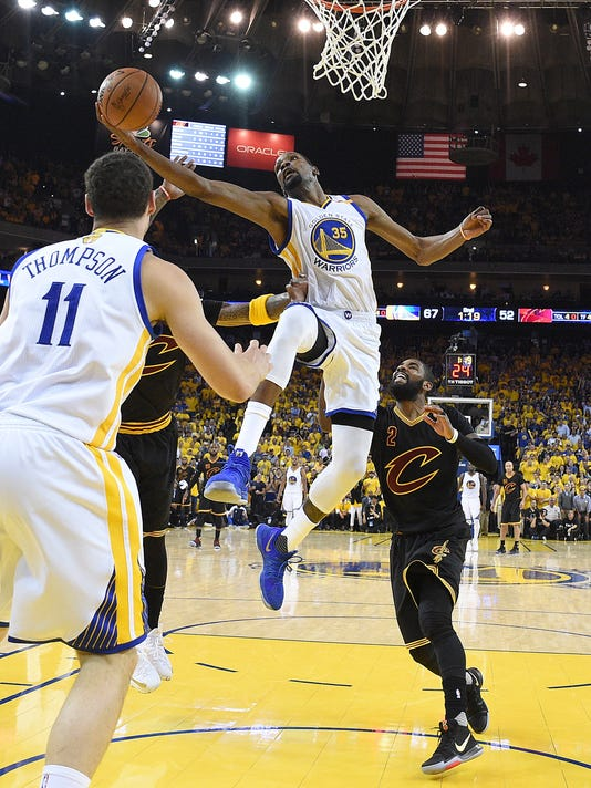 Golden State Warriors forward Kevin Durant (35) shoots against the Cleveland Cavaliers during the first half of Game 5 of basketball's NBA Finals in Oakland, Calif., Monday, June 12, 2017. (Kyle Terada/Pool Photo via AP)