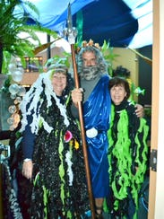 Principal Tim Reilly as King Triton among the seaweed