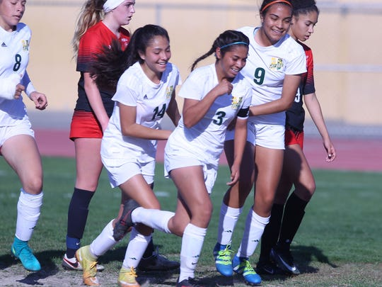 Coachella Valley's Mariah Godinez, #3, celebrates her goal against Grace Brethren during the CIF SS Division 6 quarterfinals with her team on Friday, February 24, 2017 in Thermal.