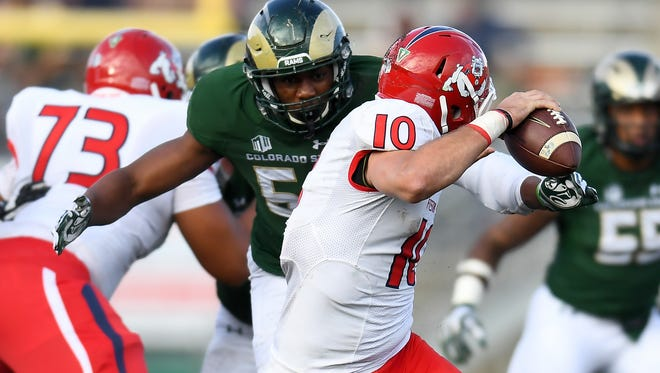 Defensive end Arjay Jean, one of nine true freshmen who played for the CSU football team last fall, closes in to sack Fresno State quarterback Zach Cline during a Nov. 5 game at Hughes Stadium.
