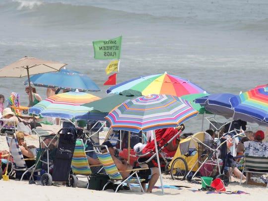 Umbellas line the beach near 8th Street in Surf City.