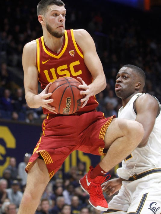 Southern California's Nick Rakocevic, left, rebounds in front of California's Kingsley Okoroh during the first half of an NCAA college basketball game, Thursday, Jan. 4, 2018, in Berkeley, Calif. (AP Photo/George Nikitin)