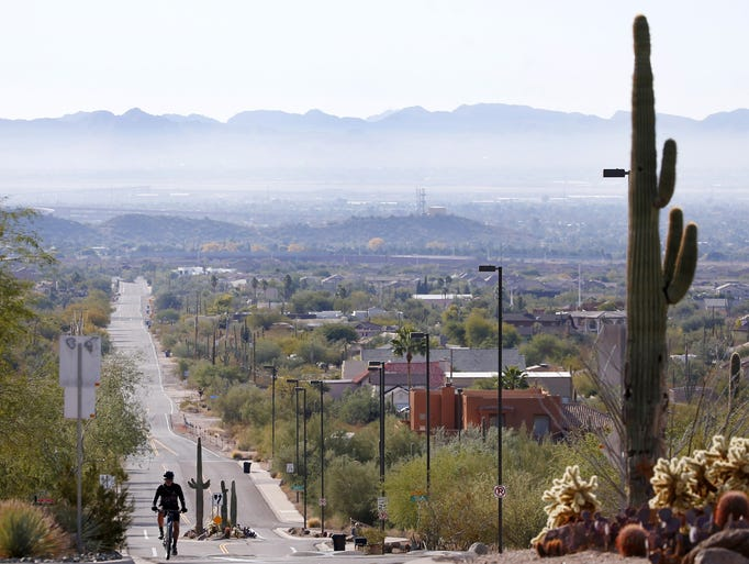 Smog can be seen lingering around the San Tan Mountains