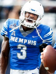 Memphis receiver Anthony Miller celebrates a 68 yard touchdown against UCF during second quarter action of the the AAC Championship football game in Orlando, Fl., Saturday, December 2, 2017.