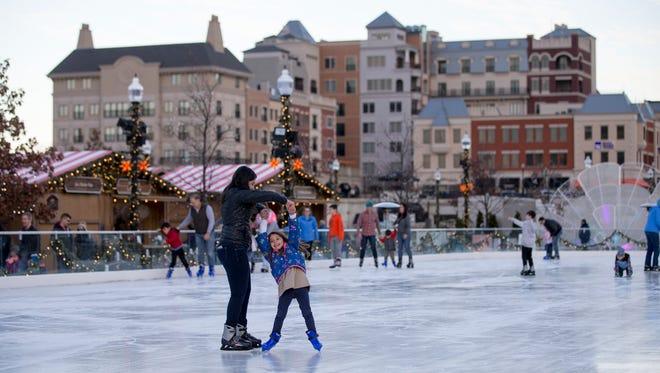 Ice skaters on an unseasonably warm afternoon at Carmel's Christkindlmarkt, Carmel, Wednesday, Nov. 29, 2017.