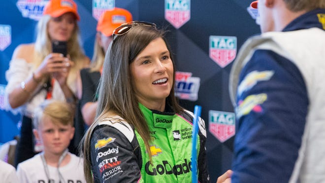 Danica Patrick shakes the hand of Max Chilton, during the 102nd running of the Indy 500 on lap 67, at Indianapolis Motor Speedway on Sunday, May 27, 2018.
