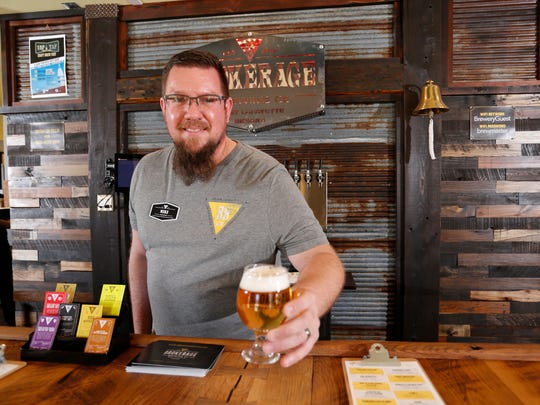 Curator Mike Vanaman serves up a glass of Walking Ashland,