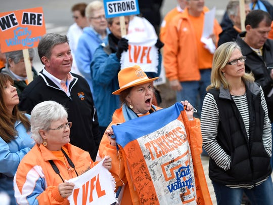 """Sylvia Billingsley, center, rallies with other protestors to bring the """"Lady Vols""""  brand and logo back to UT women's athletics, at UT's Pat Summit Plaza before the Tennessee-Stanford women's basketball game on Saturday, Dec. 20, 2014."""