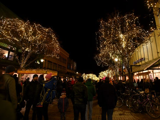 People stroll down the Church Street Marketplace in