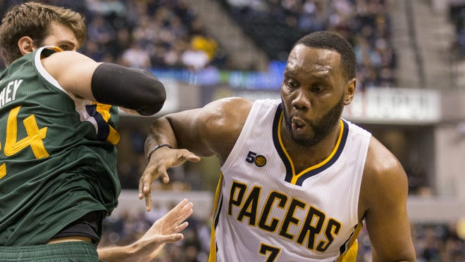 Al Jefferson of Indiana, works against Jeff Withey of the Utah Jazz at Indiana Pacers, Bankers Life Fieldhouse, Indianapolis, Monday, March 20, 2017. Indiana won 107-100.