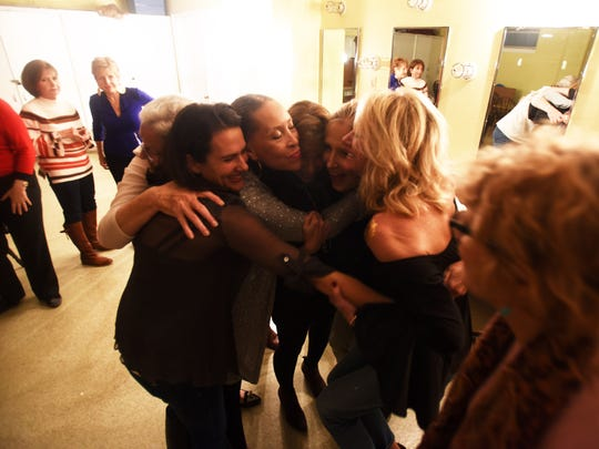 A group of friends gather for a hug backstage before they tell their story at All Y'all Live: Love at the Woman's Department Club.