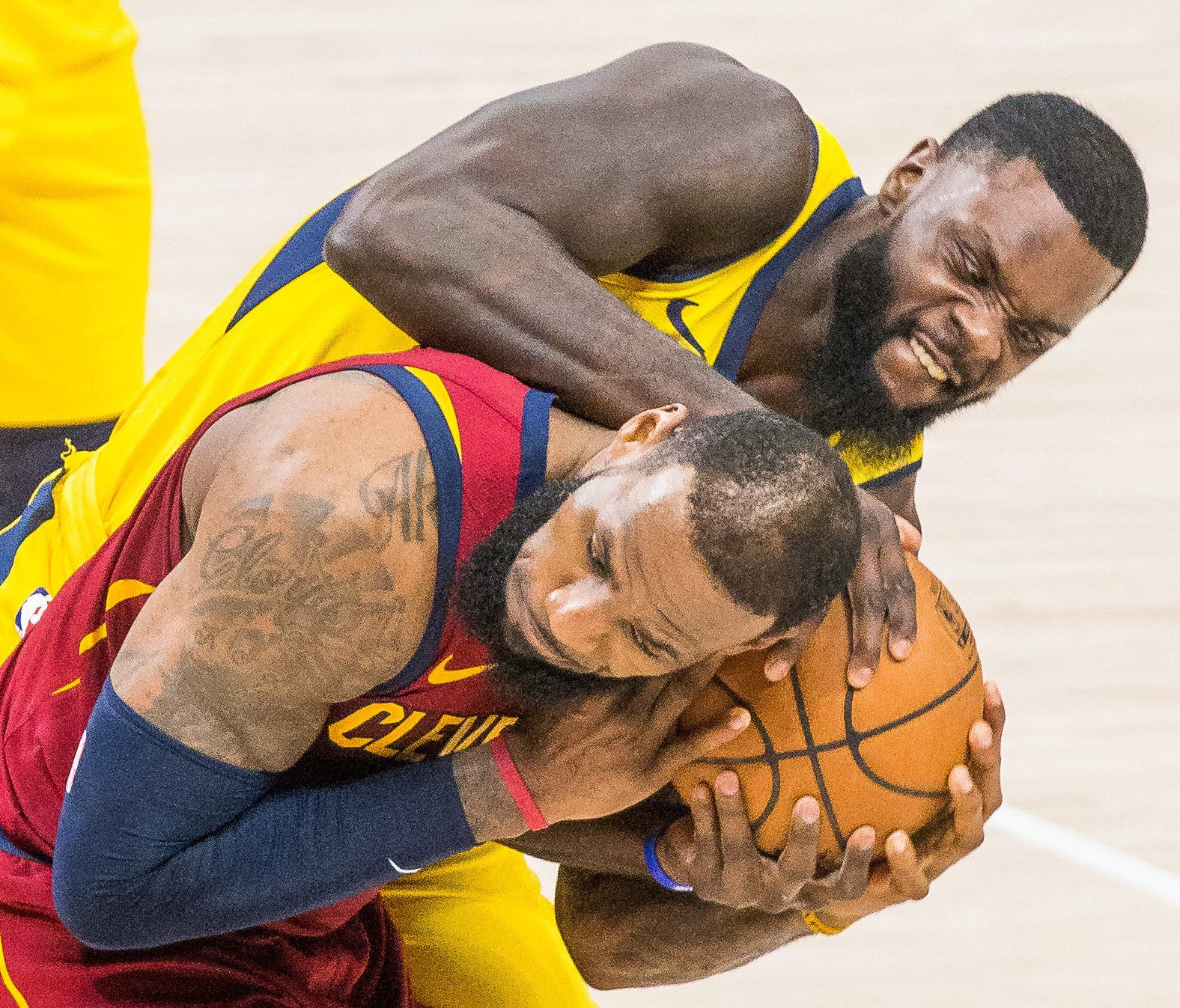 Pacers guard Lance Stephenson (1) wraps up the ball for a jump ball over Cavaliers forward LeBron James.