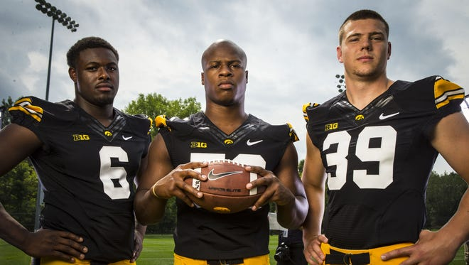 Iowa linebackers Reggie Spearman, left, Quinton Alston and Travis Perry at Iowa football media day Aug. 4 in Iowa City.