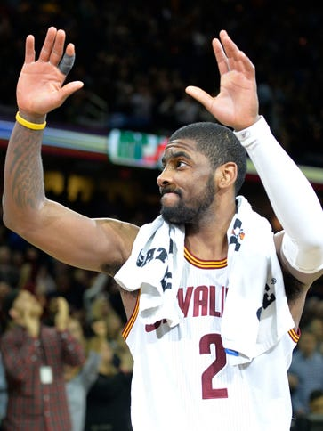 Cleveland Cavaliers guard Kyrie Irving (2) celebrates