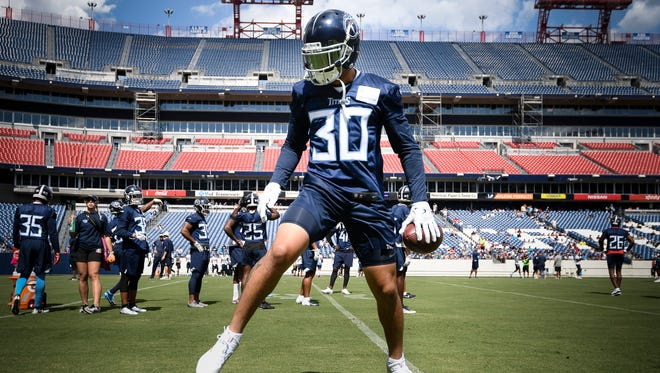 Titans safety Kenny Vaccaro (30) taps his toes along the sideline as he makes a catch during a training camp practice at Nissan Stadium Saturday, Aug. 4, 2018, in Nashville, Tenn.