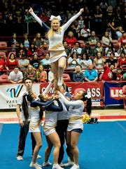 The Ruidoso High School cheerleaders perform a lift