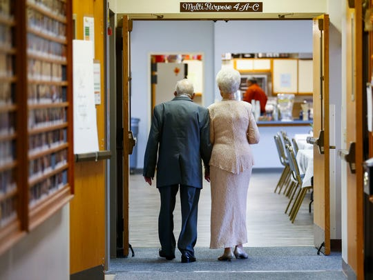 Ruth and Doyal Lindsey make their way out of the church sanctuary and into the multipurpose room after a vow renewal ceremony celebrating their 75th wedding anniversary at the Sunset Church of Christ on Saturday, Nov. 18, 2017.