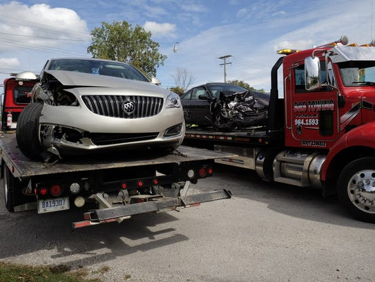 Vehicles are towed away following a crash Wednesday