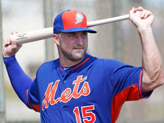 FILE - In this Sept. 19, 2016, file photo, New York Mets' Tim Tebow stretches out before batting practice at the team's complex in Port St. Lucie, Fla. The former NFL quarterback struck out twice, grounded into a double play, was hit by a pitch and trapped off first base Wednesday, March 8, 2017,  in a spring training exhibition against Boston. Tebow batted eighth as the designated hitter for a split squad of Mets. AP Photo/Wilfredo Lee, File)