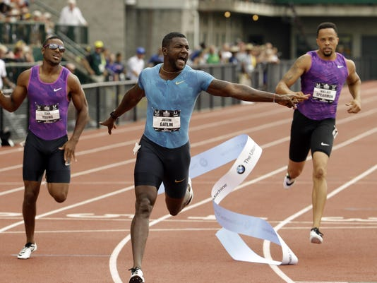 Justin Gatlin, Isiah Young, Wallace Spearmon