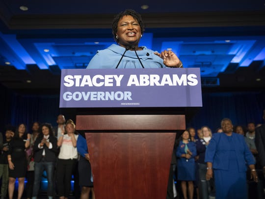 Georgia Democratic gubernatorial candidate Stacey Abrams speaks to supporters about her expectations of a run-off during an election night watch party, Tuesday, Nov. 6, 2018, in Atlanta.