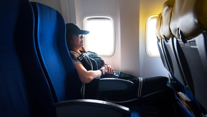 To help avoid blood clots on long plane flights, do calf raises while seated or get up and move around to keep the blood circulating.