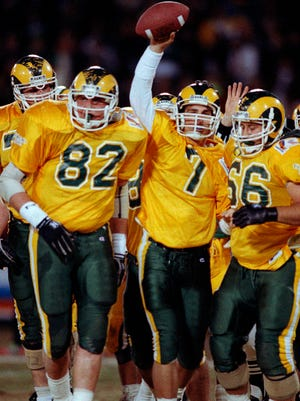 Colorado State quarterback Mike Gimenez (7) raises the ball over his head after scoring the team's first touchdown Dec. 29, 1990 against Oregon at the Freedom Bowl in Anaheim, California. For the first time since 1990, all four Front Range teams are on the brink of the postseason.