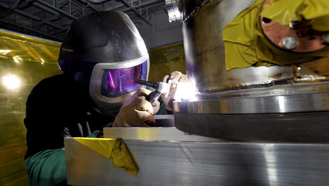 This file photo from 2012 shows Jason VanAken cryogenically welding a section of a prototype accelerator cavity made of niobium and titanium as part of the construction on MSU's Facility for Rare Isotope Beams. LEAP has created a stratgic plan to develop the particle acceleration around the existing cyclotron at MSU and the FRIB project.