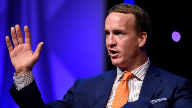 Former NFL quarterback Peyton Manning waves goodbye after speaking during the Middle Tennessee Sports Awards at the Music City Center Thursday May 26, 2016, in Nashville, Tenn.