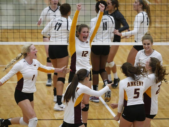 Members of the Ankeny volleyball team celebrate after scoring a point during their match at Ankeny Centennial on Sept. 27. The Hawkettes went on to win the match in five sets, allowing them to tie Centennial and Valley for the CIML Central Conference title.