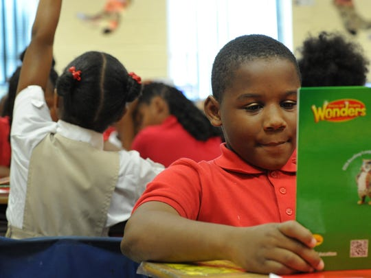 Westwood Elementary student Curshon Williams reads a book in class Wednesday.