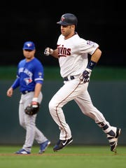Minnesota Twins' Joe Mauer rounds the bases on a solo home run off Toronto Blue Jays' pitcher Marco Estrada during the first inning of a baseball game Tuesday, May 1, 2018, in Minneapolis.