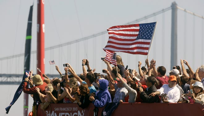Spectators cheer at Pier 27 after Oracle Team USA won the fourth race of the America's Cup sailing event against Emirates Team New Zealand  Sept. 8 in San Francisco.