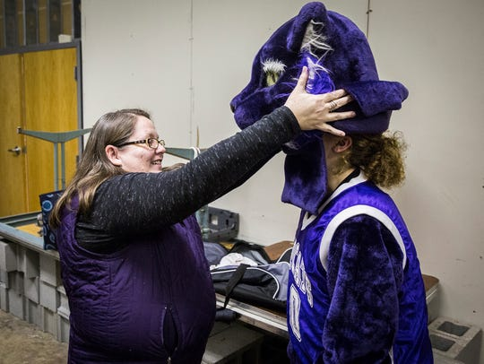 Angie Abrams-Rains helps the Central mascot take a