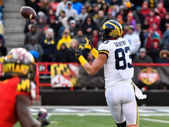 Michigan tight end Zach Gentry (83) scores a touchdown against Maryland during the first half on Saturday, Nov. 11, 2017, in College Park, Md.