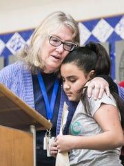 Sharon Cannon, left, hugs fifth-grader Brianna Maldonado,