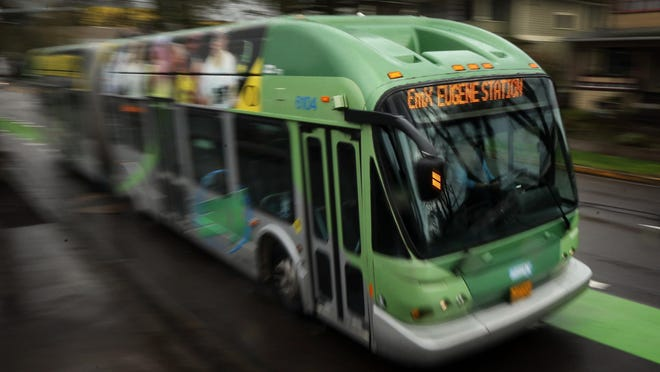 A Lane Transit District EmX makes its way down East 11th Avenue.