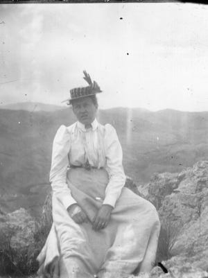 Libby Coy Lawrence atop Horsetooth Rock.