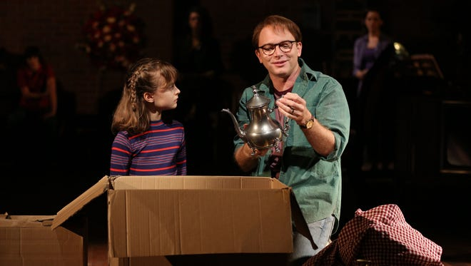 Sydney Lucas, left,  and Michael Cerveris perfom in Fun Home, with music by Jeanine Tesori, book and Lyrics by Lisa Kron, based on the Alison Bechdel book, and directed by Sam Gold, running at The Public Theater at Astor Place.