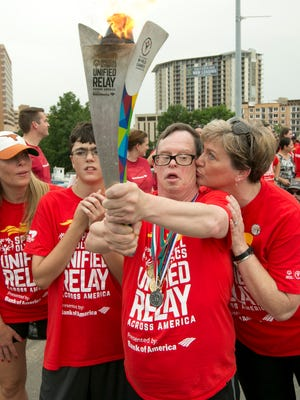 Allan Cole, 54, an athlete from Johnson City, Tenn., carries the Special Olympics World Games Torch. To bring the nation together for awareness and understanding of the Special Olympics' mission, more than 10,000 people carried the Flame of Hope coast to coast across the United States. The Flame of Hope has now been delivered to Los Angeles.
