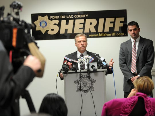 Fond du Lac County Sheriff Mick Fink speaks to reporters