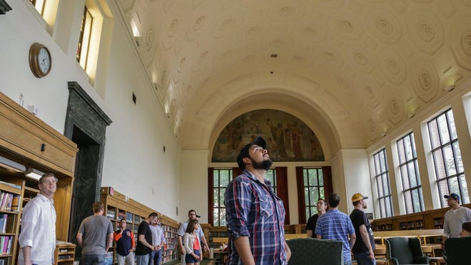 Rafael Rodriguez of Edinburg, Texas, looks around the reference reading room at the University of Michigan's Harlan Hatcher Graduate Library during a tour Friday.
