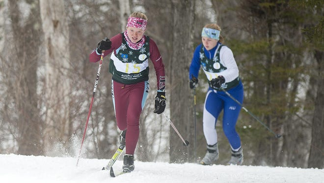 North Country's Callie Young climbs a hill in a girls classic relay during last year's state championships in Ripton.